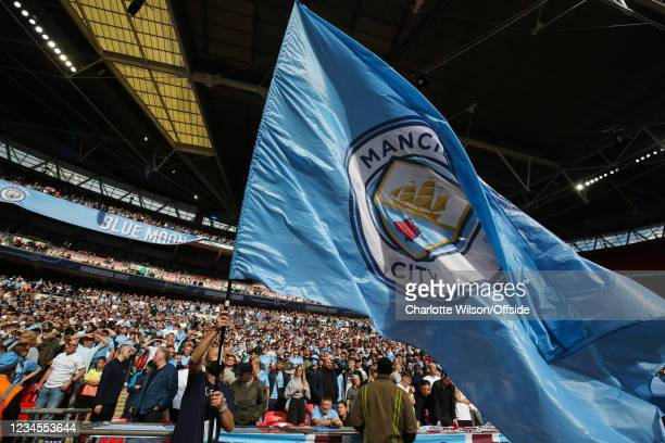 Man City fans at Wembley as a large flag is waved during the FA Community Shield match between Leicester City and Manchester City at Wembley Stadium...