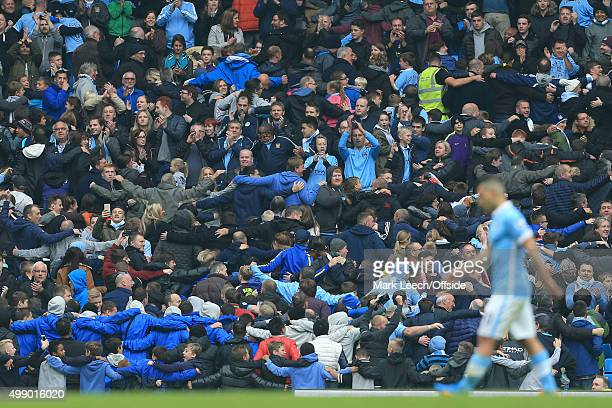 Man City fans celebrate by performing their 'Poznan' dance as Sergio Aguero of Man City walks off after being substituted having scored 5 goals...