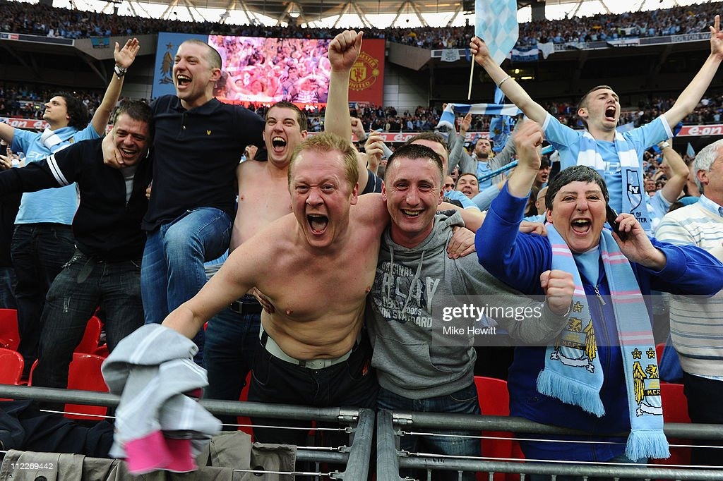Man City fans celebrate victory at the FA Cup sponsored by E.ON semi final match between Manchester City and Manchester United at Wembley Stadium on April 16, 2011 in London, England.