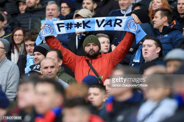 Man City fans holds up a scarf against the Video Assistant Referee system during the Premier League match between Manchester City and Crystal Palace...