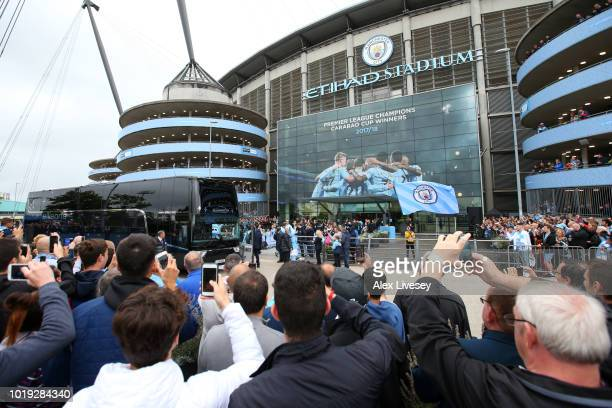 Man City fans watch the team arrive during the Premier League match between Manchester City and Huddersfield Town at Etihad Stadium on August 19 2018...