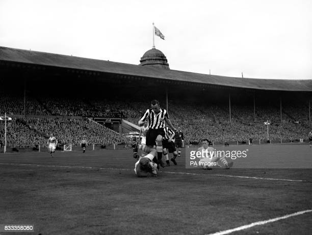 Man City goalkeeper Bernhard Trautmann gathers the ball safely when Newcastle's Victor Keeble attacks David Ewing is also on the ground in a...