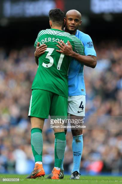 Man City goalkeeper Ederson hugs Vincent Kompany of Man City during the Premier League match between Manchester City and Swansea City at the Etihad...