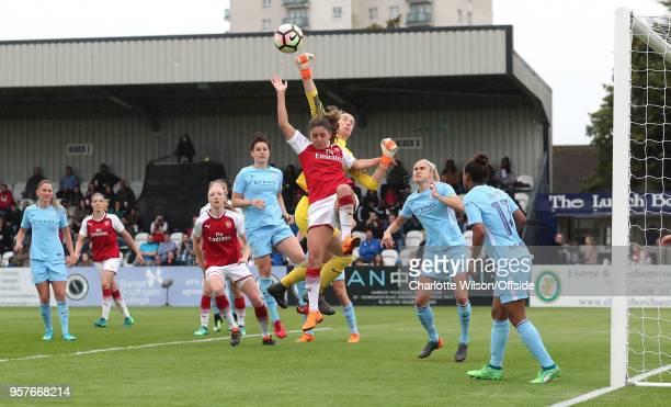 Man City goalkeeper Karen Bardsley punches the ball clear from Danielle Van De Donk of Arsenal during the Womens Super League match between Arsenal...