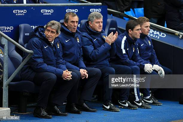 Man City manager Manuel Pellegrini sits in the dugout alongside assistants Ruben Cousillas and Brian Kidd prior to the Barclays Premier League match...