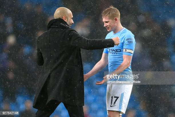 Man City manager Pep Guardiola congratulates Kevin De Bruyne of Man City after the Premier League match between Manchester City and Chelsea at the...