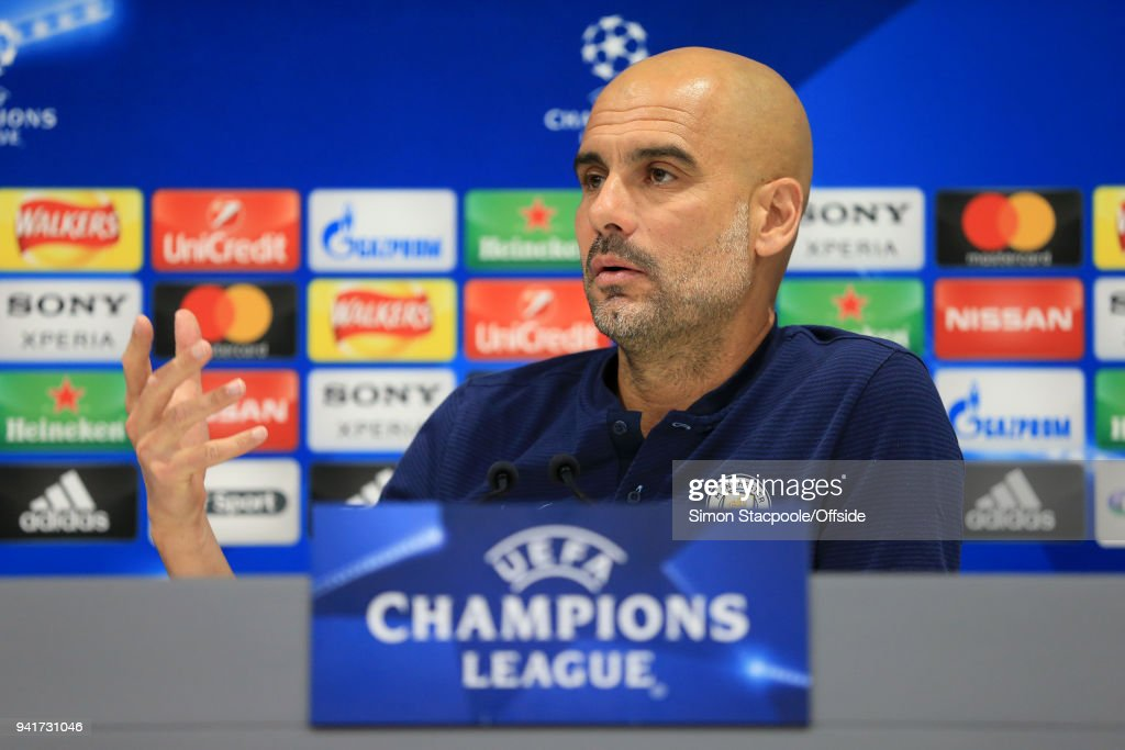 Man City manager Pep Guardiola gestures during a press conference prior to their UEFA Champions League Quarter Final First Leg match against Liverpool at Anfield on April 3, 2018 in Liverpool, England.