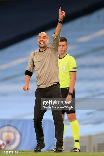 Man City manager Pep Guardiola gestures during the UEFA Champions League round of 16 second leg match between Manchester City and Real Madrid at...