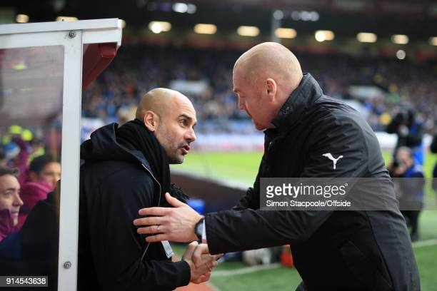 Man City manager Pep Guardiola greets Burnley manger Sean Dyche before the Premier League match between Burnley and Manchester City at Turf Moor on...
