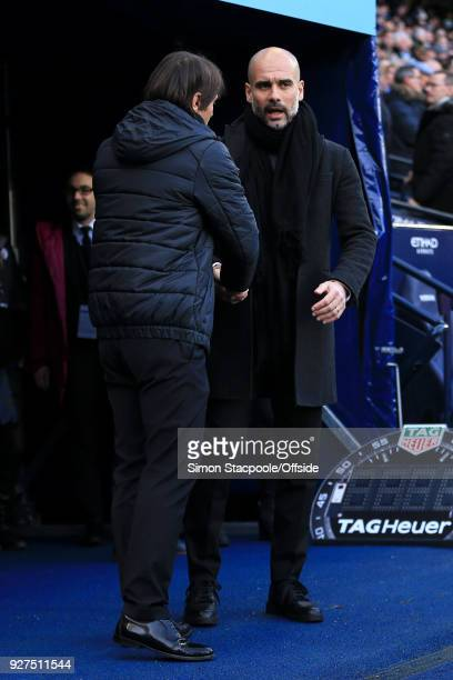 Man City manager Pep Guardiola greets Chelsea manager Antonio Conte before the Premier League match between Manchester City and Chelsea at the Etihad...
