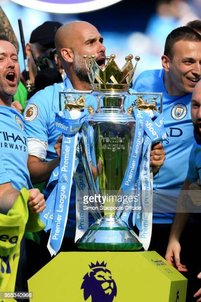 Man City manager Pep Guardiola holds the trophy at the end of the Premier League match between Manchester City and Huddersfield Town at the Etihad...