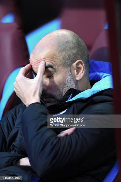 Man City manager Pep Guardiola looks dejected before the Premier League match between Aston Villa and Manchester City at Villa Park on January 12...
