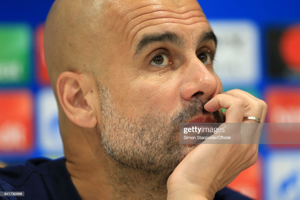 Man City manager Pep Guardiola looks on during a press conference prior to their UEFA Champions League Quarter Final First Leg match against Liverpool at Anfield on April 3, 2018 in Liverpool, England.