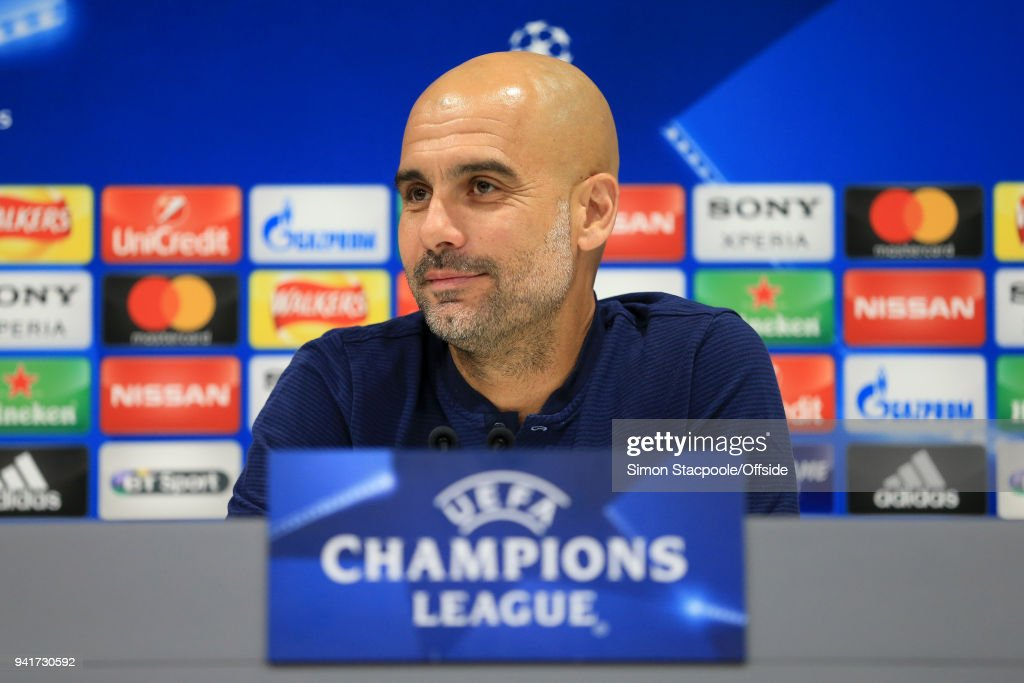 Man City manager Pep Guardiola smiles during a press conference prior to their UEFA Champions League Quarter Final First Leg match against Liverpool at Anfield on April 3, 2018 in Liverpool, England.
