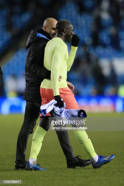 Man City manager Pep Guardiola talks to Benjamin Mendy of Man City as they walk off after the FA Cup Fifth Round match between Sheffield Wednesday...
