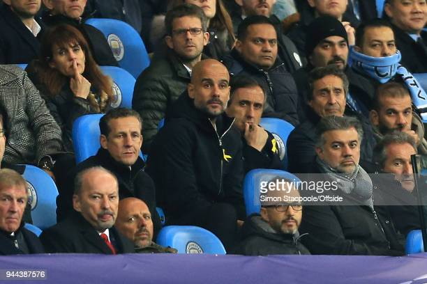 Man City manager Pep Guardiola watches from the stands after arguing with the referee over the controversial decision to rule the 2nd City goal...
