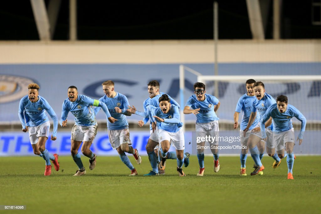Man City players celebrate victory following a penalty shootout at the end of the UEFA Youth League Round of 16 match between Manchester City and Inter Milan at Manchester City Football Academy on February 20, 2018 in Manchester, England.