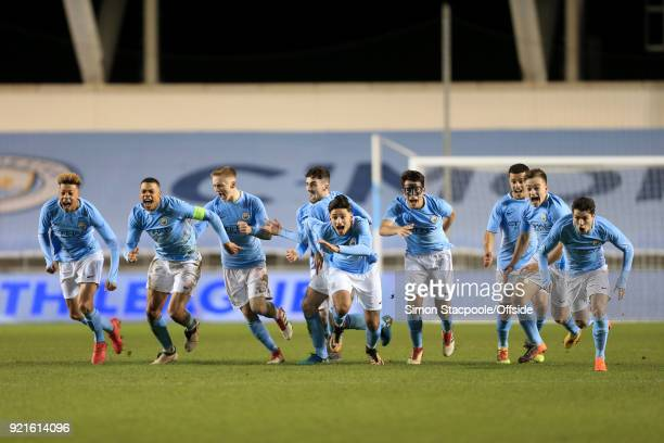 Man City players celebrate victory following a penalty shootout at the end of the UEFA Youth League Round of 16 match between Manchester City and...