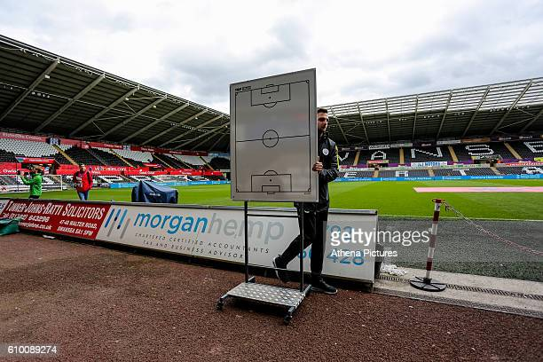 Man city staff member pushes in a tactics board to the stadium prior to the Premier League match between Swansea City and Manchester City at The...