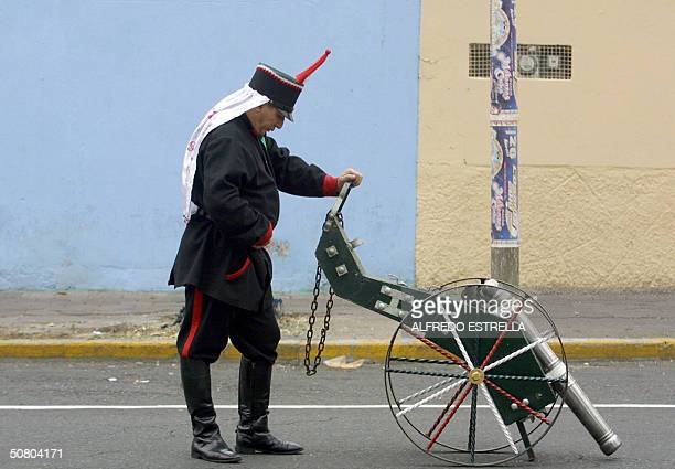A man clad as a Mexican soldier sets up his gun to fight the French army during the staging of the battle of Puebla 05 May 2004 in Puebla Mexico...