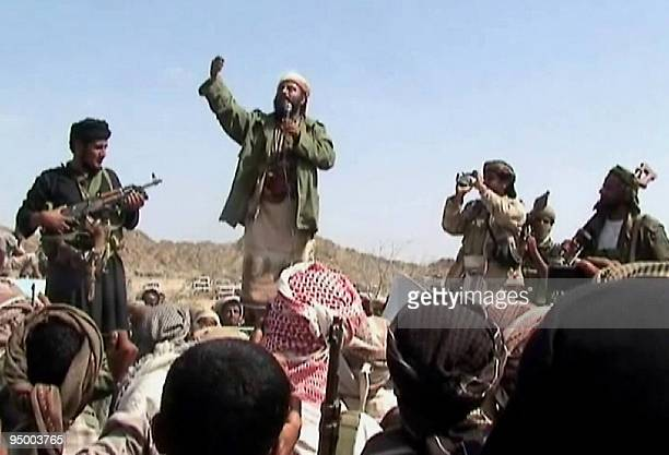 A man claiming to be an AlQaeda member addresses a crowd gathered in Yemen's southern province of Abyan on December 22 2009 Men claiming to be...