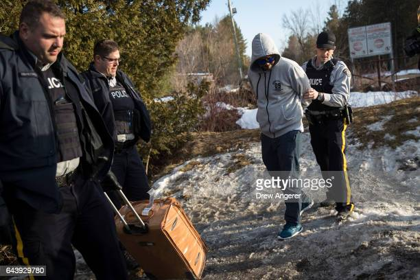 A man claiming to be from Sudan is apprehended by Royal Canadian Mounted Police officers after he crossed the USCanada border into Canada February 22...