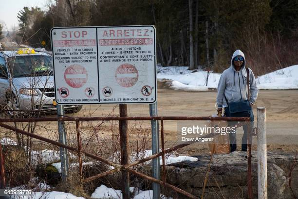 A man claiming to be from Sudan prepares to cross the USCanada border into Canada February 22 2017 in Hemmingford Quebec In the past month hundreds...