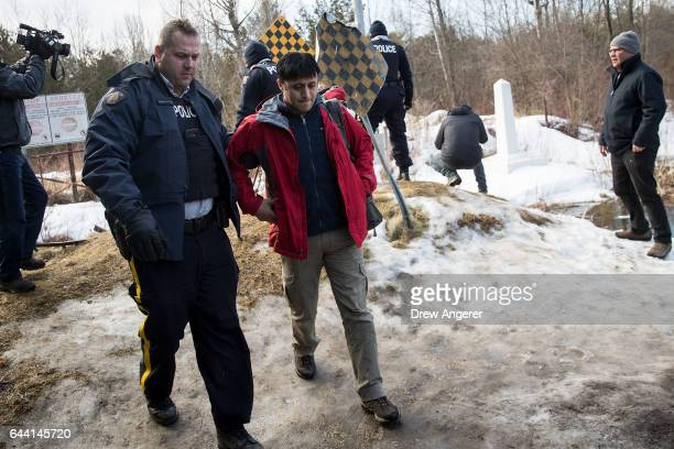 A man claiming to be from Turkey is arrested by Royal Canadian Mounted Police officers after he crossed the USCanada border into Canada February 23...