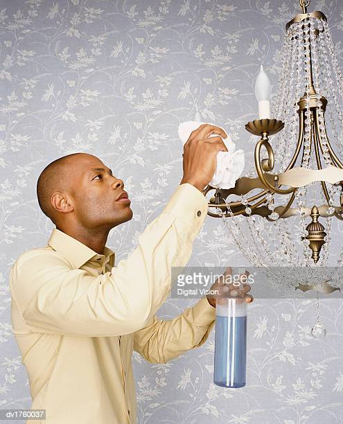 Man Cleaning a Chandelier