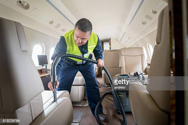 Man cleaning an airplane