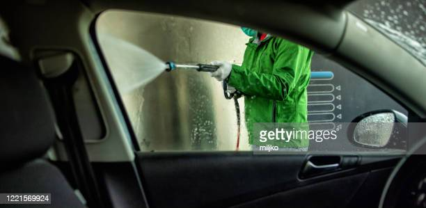 man cleaning and washing car self service - miljko stock pictures, royalty-free photos & images