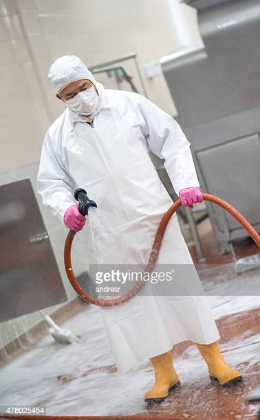 Man cleaning at a factory