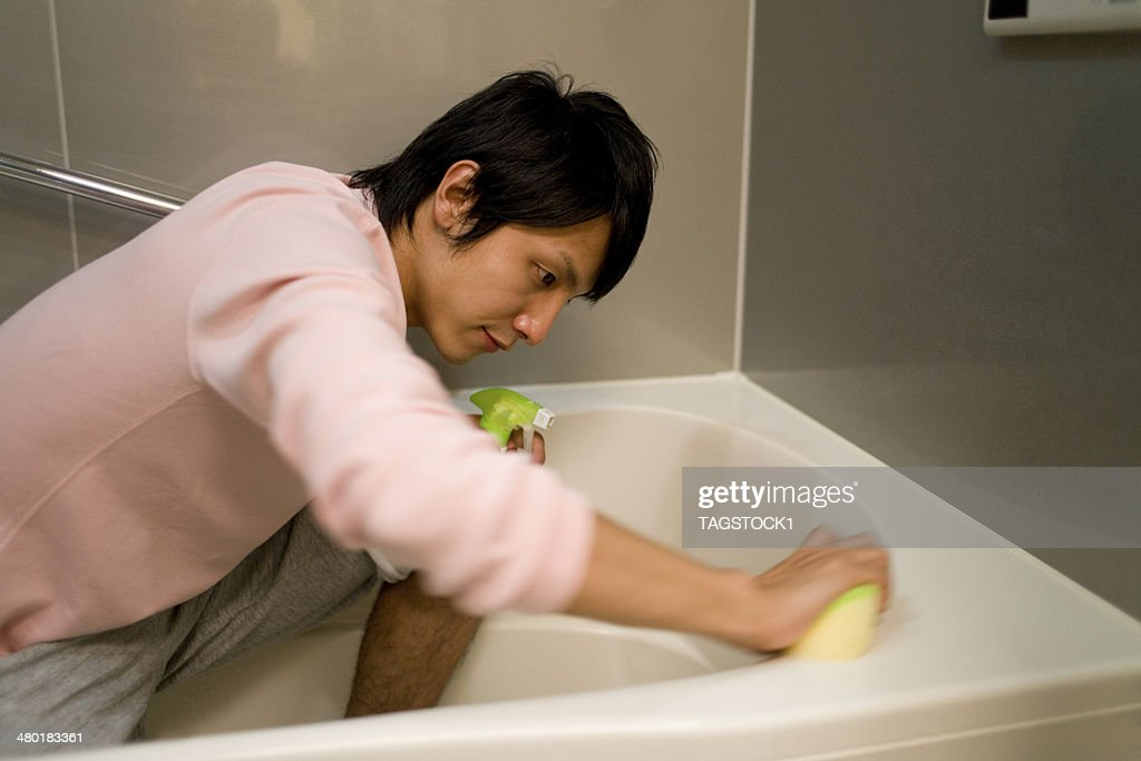Man cleaning bath : Stock Photo