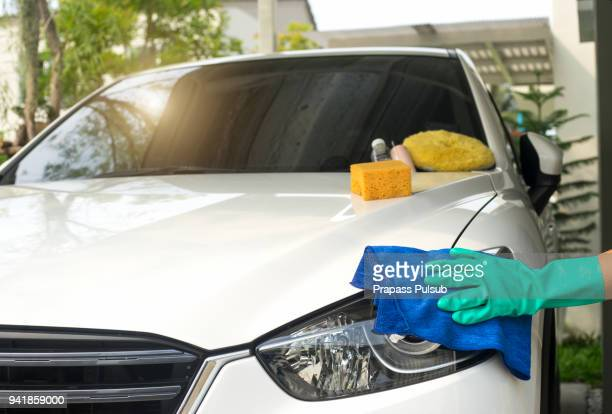 a man cleaning car with microfiber cloth, car detailing (or valeting) concept - microfiber towel stock photos and pictures