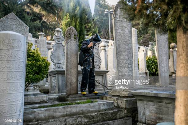 A man cleaning cemetery in front of the Eyup Sultan Mosque in Eyup Istanbul on