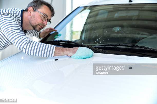 Man cleaning his car
