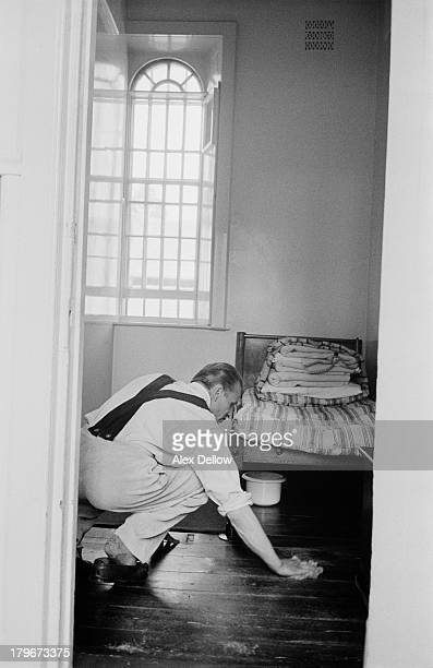 A man cleaning the floor of a room at Broadmoor Hospital a highsecurity psychiatric facility in Berkshire 1956 Original publication Picture Post 8924...