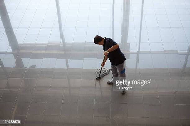 man cleaning the floor - professional cleaning stock photos and pictures