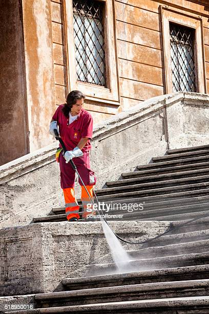Man cleaning the Spanish Steps in Rome, Italy