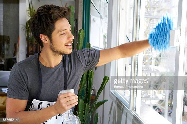 Man cleaning window panes