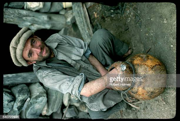 man cleaning yogurt gourd - hunza valley stock pictures, royalty-free photos & images