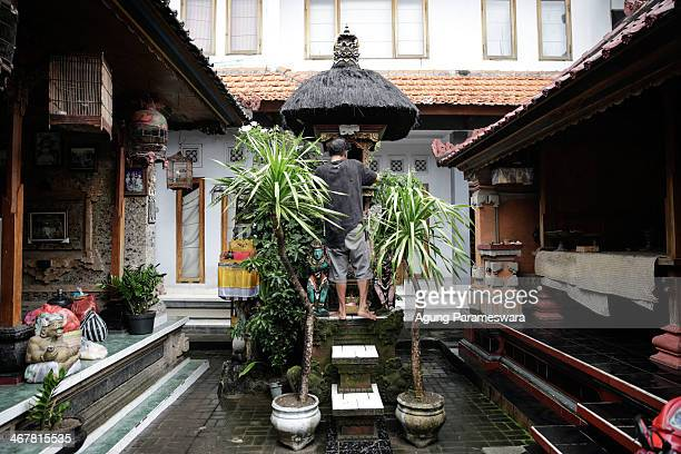 A man cleans a family temple in a house where Australian drug trafficker Schapelle Corby's sister and brother in law Mercedes Corby and Wayan...