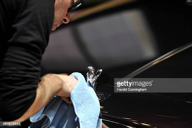 A man cleans a RollsRoyce Spirit of Ecstasy at the Geneva International Motor Show on March 2 2015 in Geneva Switzerland The 85th International Motor...