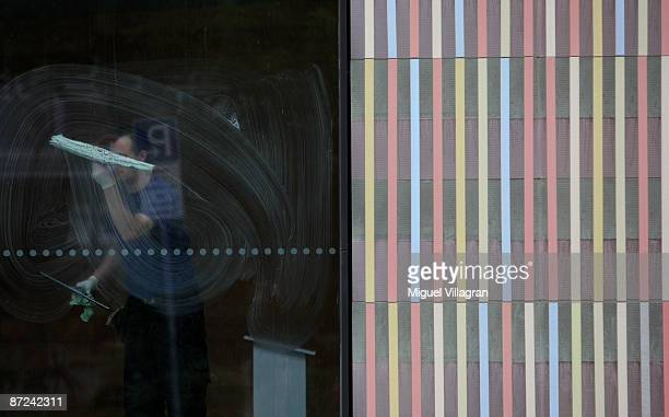 A man cleans a window of the new museum Brandhorst which was built by Sauerbruch Hutton architects on May 15 2009 in Munich The museum which shows...