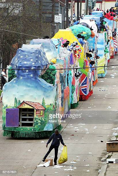 A man cleans garbage after floats pass during the Zulu parade a primarily AfricanAmerican parade during Mardi Gras festivities February 8 2005 in New...