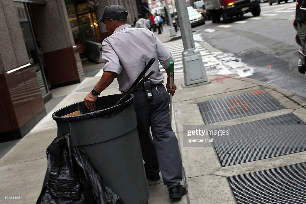 A man cleans garbage from the street on September 28, 2010 in the Brooklyn borough of New York City. A new report released by the U.S. Census Data shows that the income gap between Americans is greater than at any other time on record. The report found that the top-earning 20% of Americans received 49.4% of the country's total income. Conversely, those living below the poverty line earned 3.4% of the national income. This is the highest disparity of wealth among all Western industrialized nations.