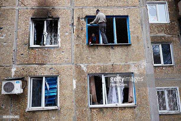 A man cleans his damaged apartment in the area near a chemical plant which has suffered artillery shellings on February 09 2015 in Donetsk Ukraine A...