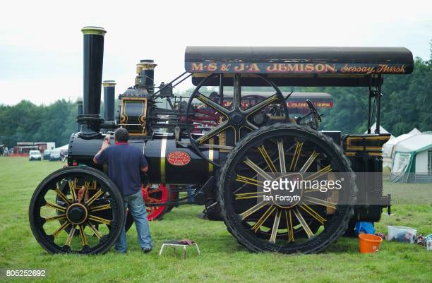 A man cleans his steam engine during the Duncombe Park Steam Rally on July 1 2017 in Helmsley United Kingdom Held annually in the picturesque...
