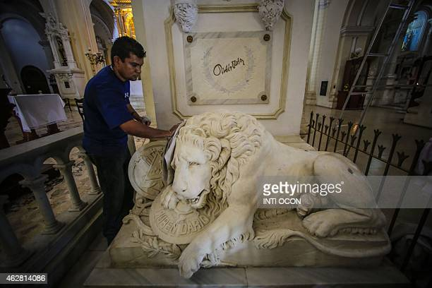 A man cleans the crypt of Ruben Dario on the centenary of his death in 'Leon Cathedral' at Leon City some 100 km from Managua on February 5 2015 AFP...