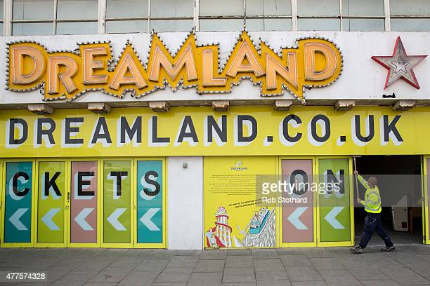 A man cleans the entrance to the Dreamland amusement park site on June 18 2015 in Margate England Dreamland is considered to be the oldestsurviving...